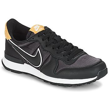 buy popular 520fb 4e4b2 Chaussures Femme Baskets basses Nike INTERNATIONALIST HEAT Noir   Doré